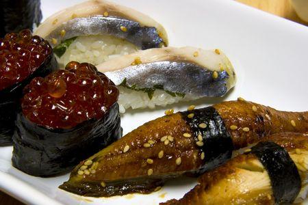 White plate full of japanese food. photo
