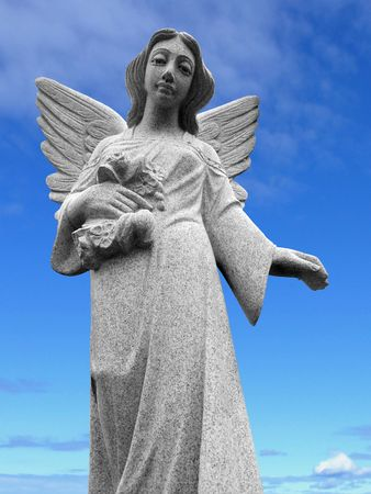 weeping angel: An angel scuplture with a blue sky background.