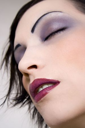 Young woman with beautiful cosmetics. Stock Photo