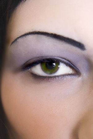 A woman with green eyes.