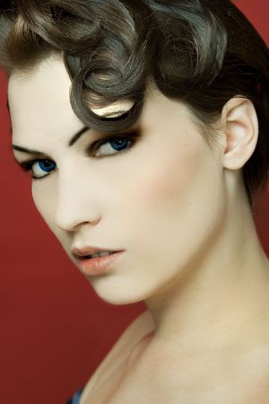 A female pinup model with a fashion hair style. photo