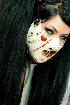 Female in Halloween mask. photo