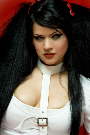 Scary Halloween Model with big hair and straight jacket photo