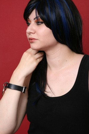 Blue haired punk girl on red background photo