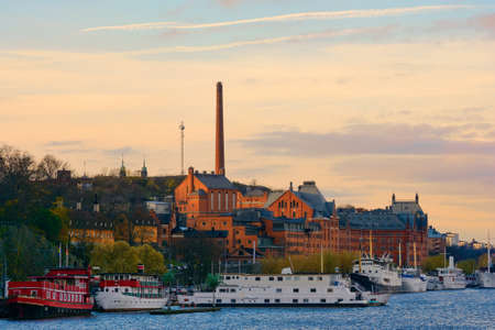 converted: Boats and buildings in Sodermalm in Stockholm. Many af the boats are converted into hotels