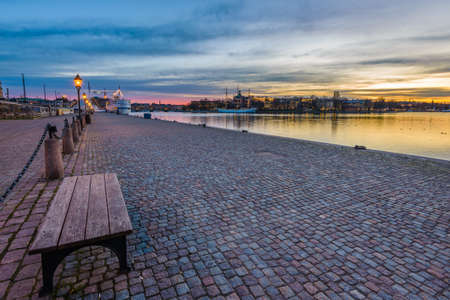 gamla stan: View from the quay of Gamla Stan towards the rising sun in Stockholm, Sweden