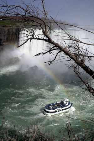 niagara falls: Lovely view of Niagara Falls with boat and rainbow Stock Photo