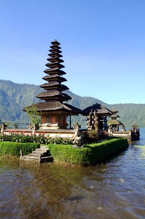 Vertical view of picturesque temple on lake in extinct volcano crater photo