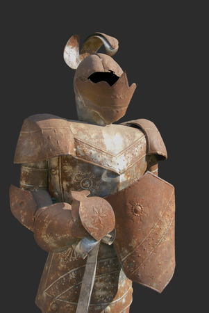 Rusty suit of armor isolated on slate background Banco de Imagens