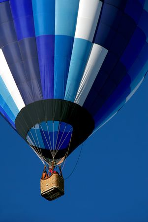 iluminate: Colorful hot air balloon in shades of blue with ?Hi Mom? on bottom of gondola