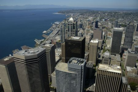 Seattle skyline from above, with aview on Puget Sound and Olympic Peninsula
