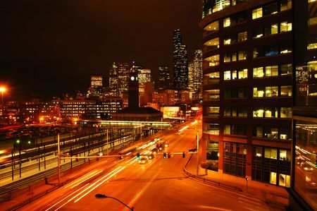 Night traffic in downtown seattle with a view on King Station photo
