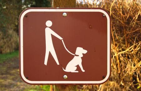 Dogs on leash symbolic sign Stock Photo - 2578004