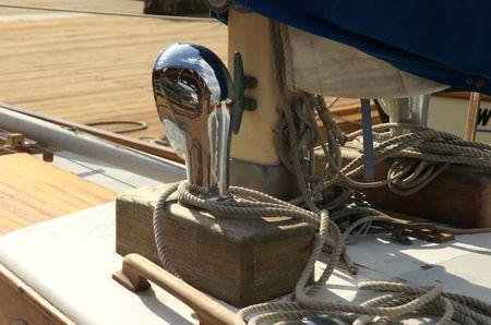 cleat: Sailing boat detail with achrome tube, ropes and cleat