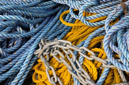 cordage: Pile of color ship cordage and chain Stock Photo