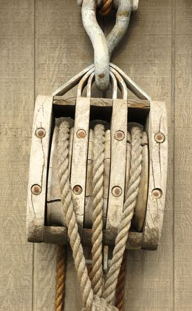 cordage: Old wooden block with a rope