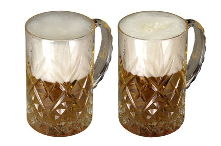 cutglass: Two cut-glass mugs full with beer and foam Stock Photo