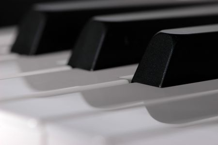 Closeup of a piano keyboard with focus on a single key