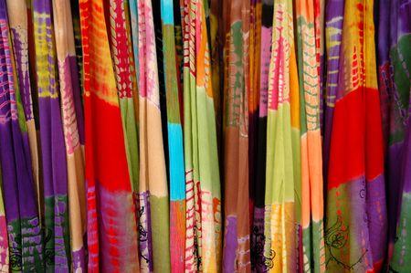 Rack of colorful summer light tie-dye dresses Stock Photo