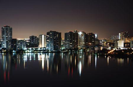 Night view on Aventura from Sunny Isles  over Intercoastal Waterway photo
