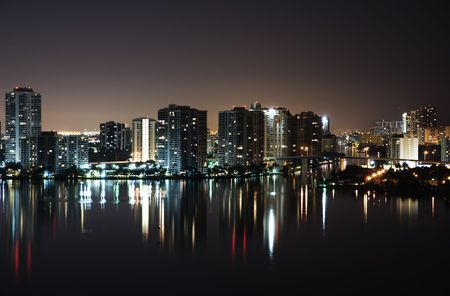 Night view on Aventura from Sunny Isles  over Intercoastal Waterway photo