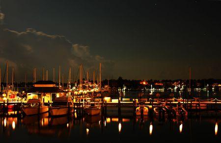 Boats and yachts at Naples Bay marina after sunset Stock Photo