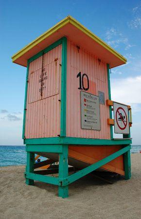 Colorful lifeguard stands at Sunny Isles Beach, Florida photo