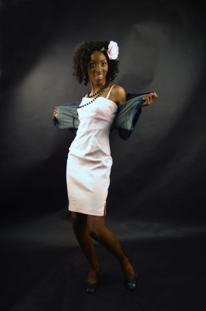 Gorgeous african-american model in a pink dress, denim jacket and pink camellia in the hair. Stock Photo - 3897316