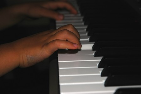 Close up of child hands playing piano Stock Photo - 4188919