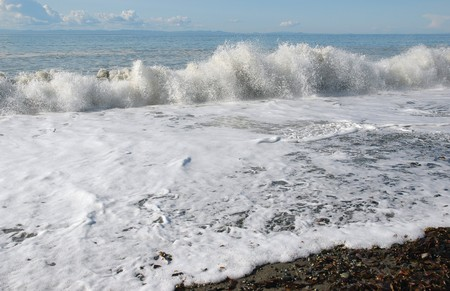 strait of juan de fuca: Wave crashing ashore of Strait of Juan De Fuca
