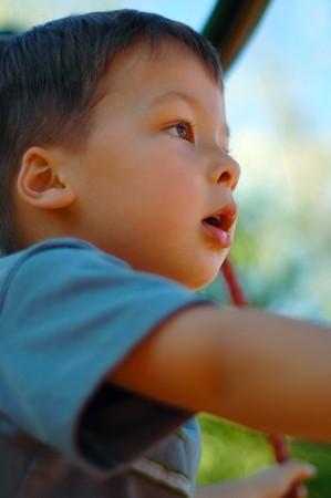 Boy looking far of with a fascination Banco de Imagens