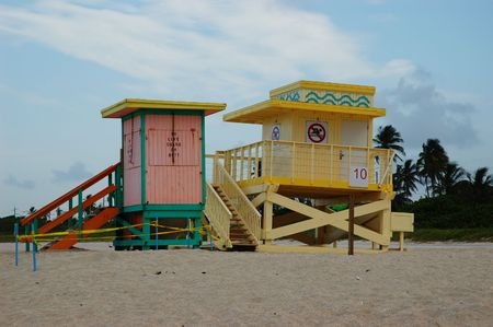 Pink and turquoise, and yellow lifeguards stands at North Miami Beach photo