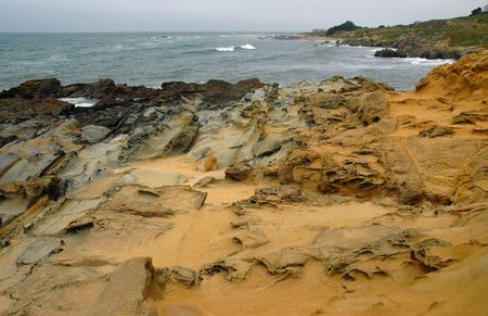 concave: Sandstone formations in landscape of Pebble beach, California