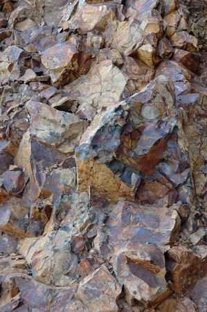 durable: Close-up fragment of brown mountain rock