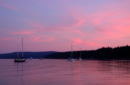 spencer: Boats at sunset along the coast of Spencer spit park, Lopez Island, Washington