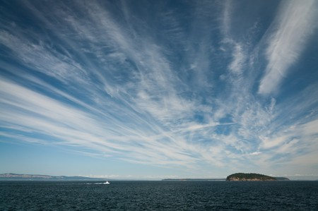 Strands of cirrus clouds above the Puget sound Stock Photo