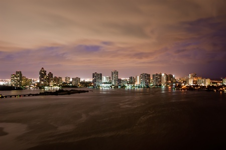 Night view on Aventura from Sunny Isles Beach over Intercoastal Waterway, Florida photo