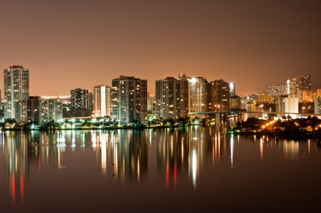 Night view on Aventura from Sunny Isles Beach over Intercoastal Waterway photo