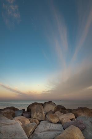 Rock pier at sunset