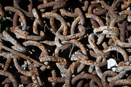 Rusty chain pile close-up Stock Photo