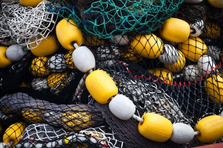 floats: Tangled fishing nets with yellow and white floats