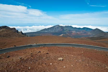 Road winding above Haleakala crater in Maui, Hawaii photo