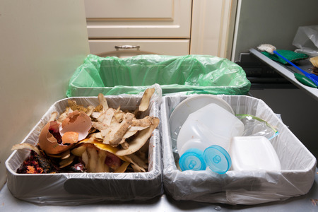 household waste: Household waste sorting and recycling kitchen bins in the drawer. Environmentally responsible behavior concept, ecology concept. Stock Photo