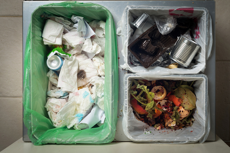 Household waste sorting and recycling kitchen bins in the drawer. Responsible behavior, ecology concept. Archivio Fotografico