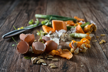 composting: Organic leftovers, waste from vegetable ready for recycling and to compost. Collecting food leftovers for composting. Environmentally responsible behavior, ecology concept.