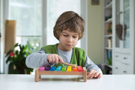 Cute little playing on xylophone. Musical education, help recognize musical talent, how to support and encourage childrens creativity Stock Photo
