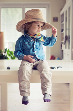 Cute little boy dressed as cowboy Banco de Imagens