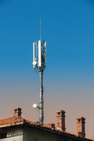 widespread: GSM base station on the roof of of the old house. There is widespread public concern about thepotential adverse health effects of mobile phones and especially their associated base stations.