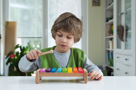 educational: Cute little playing on xylophone. Musical education, help recognize musical talent, how to support and encourage childrens creativity Stock Photo