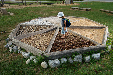 Playground filled with different materials allowing children to explore a variety of different textures to feel under their feet. It helps children to build their physical skills, as well as their cognitive understanding.